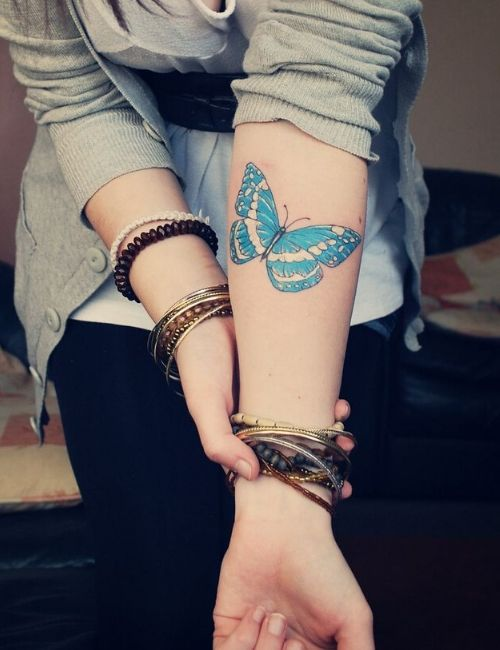 Butterfly tattoo on girl arm