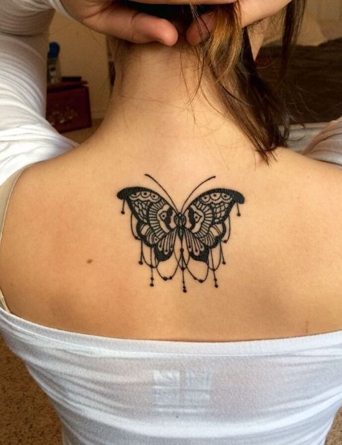 butterfly tattoo on neck