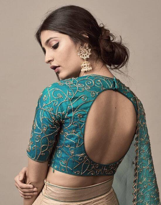 Embrodary with back less blouse designs