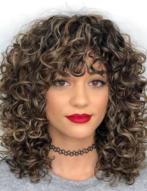 Mid-Length Curly Hairstyle with Curly Bangs