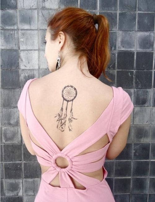 Dreamcatcher tattoo for woman on Back side