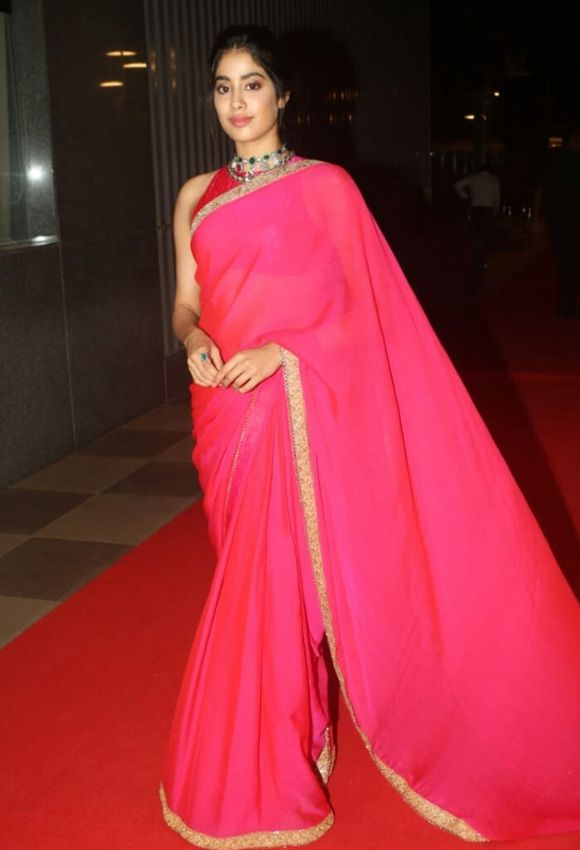 Jahanavi in red saree with sleeve blouse design