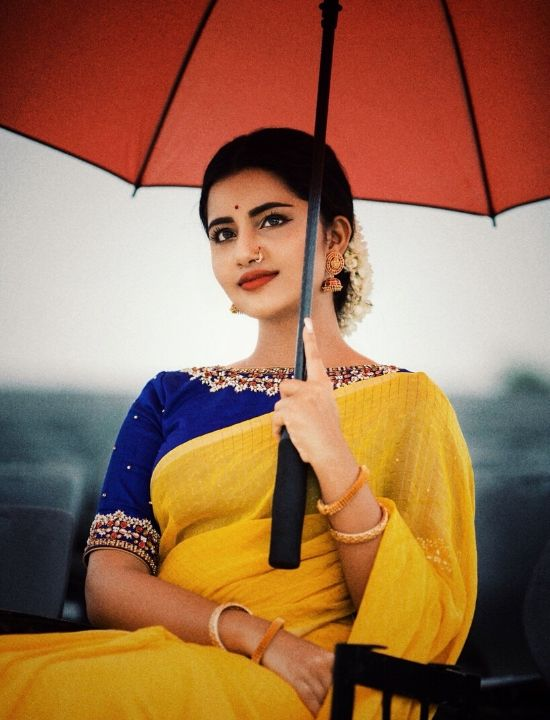 anupama parameswaran Yellow saree with blue blouse