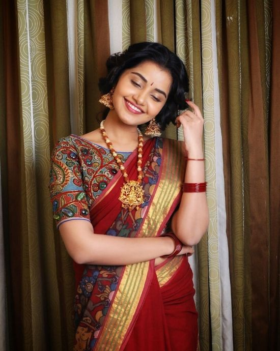 anupama parameswaran in red pattu saree