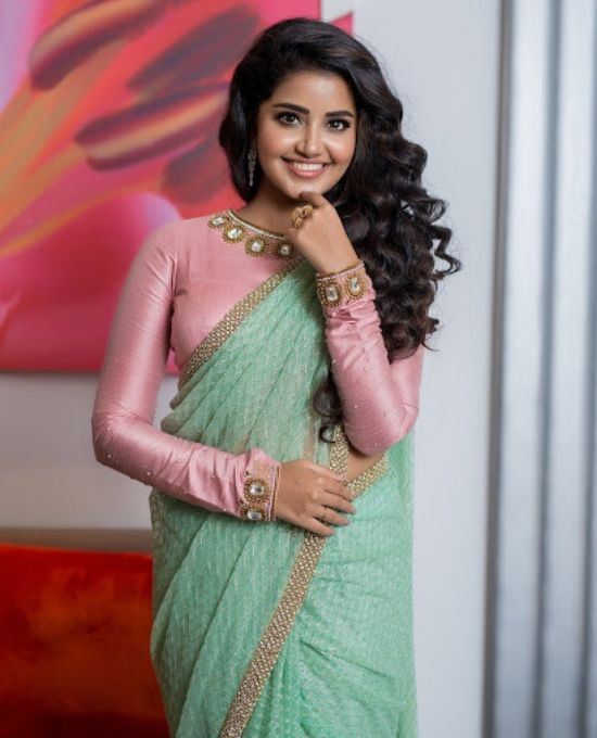 anupama parameswaran with full hands blouse with culry hair