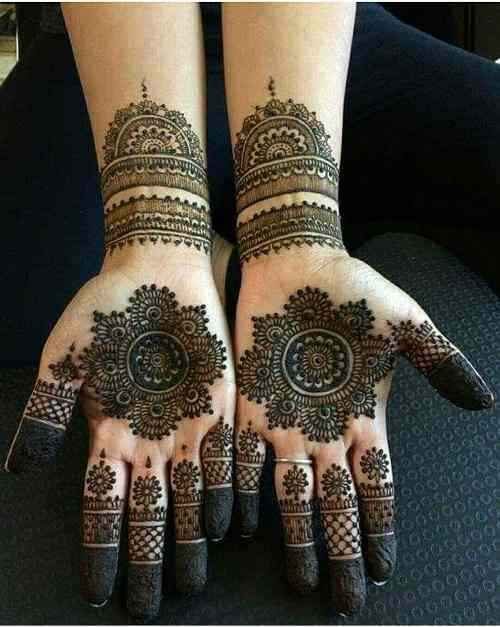 Round mehndi design on palm
