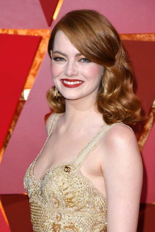 copper-red hair was tossed over to the side in elegant
