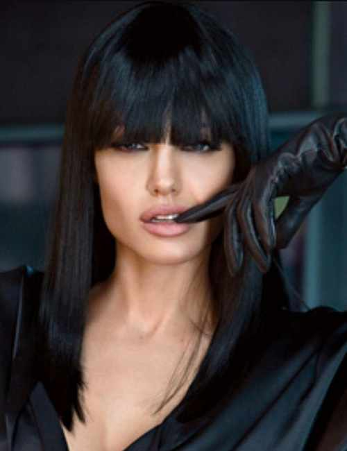 raven hair is styled in long straight style with cutout bangs