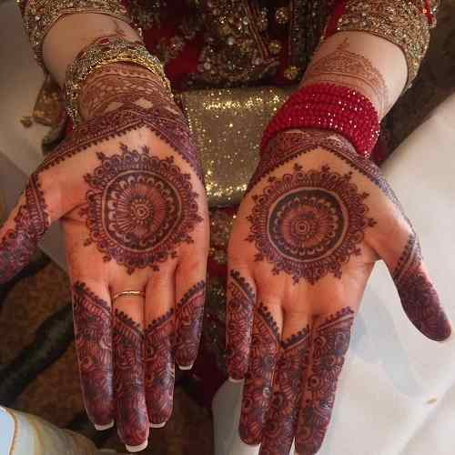 simple circle mehndi for front hands