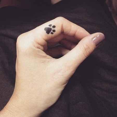 Dog paw small tiny tattoo