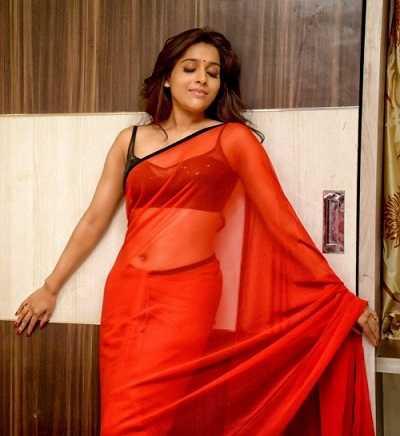 Rashmi Gouthami in Red transpernt saree