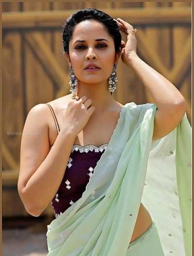anasuya Bharadwaj in low waist saree