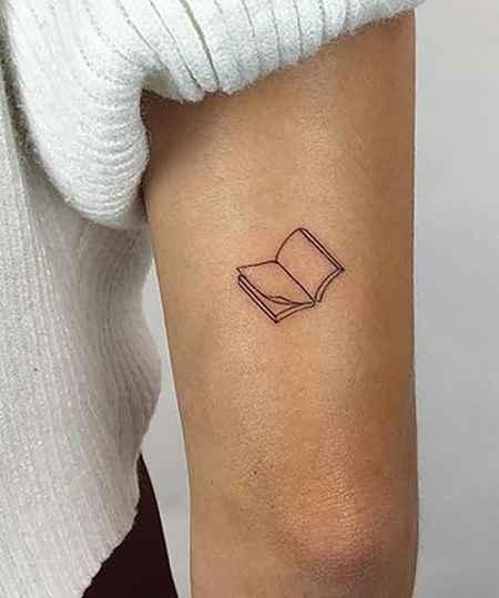 book tatoo on arms