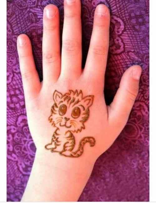 Little Cat on Back Hand