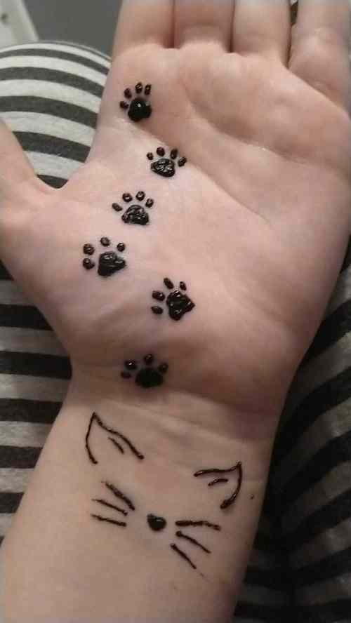 cat paws on kids hands