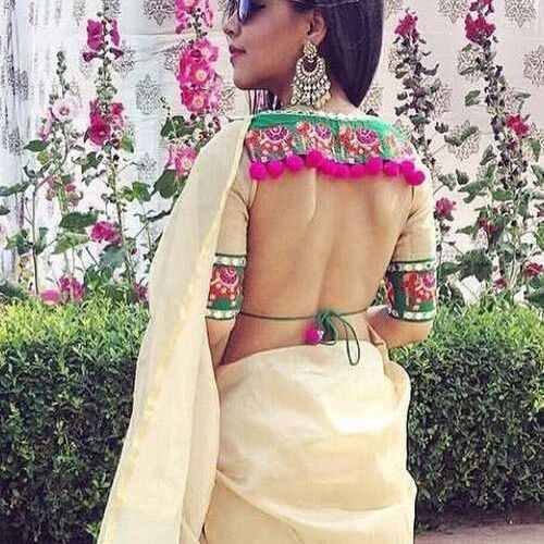 Backless blouse with pom pom and patch work